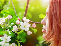Young girl smelling blossoms Stock Photo