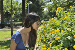 Young girl smelling flowers Royalty Free Stock Photos
