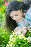 Young girl smelling flowers. Royalty Free Stock Images