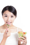 Young Girl Smile eating salad Stock Photo
