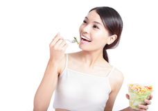 Young Girl Smile eating salad Stock Image