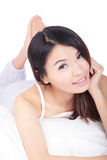 Young girl smile face while lying on bed Royalty Free Stock Image