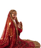 Young girl smile in oriental red indian costume Royalty Free Stock Photo