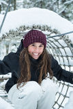 Young girl smiles at winter. And enjoys playing in the snow. Québec, Canada Stock Photography