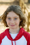 Young girl smiling. Ten year old girl outdoors looking at the camera and smiling Royalty Free Stock Images
