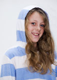 Young Girl Smiling. Young girl in hooded top smiling , closeup Royalty Free Stock Image