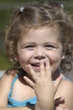 Young girl smiling. Young girl in the sunshine smiling and playing royalty free stock photography
