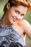 Young girl, smiling. Portrait of young smiling girl with red hair Stock Images