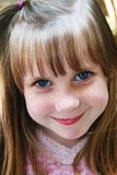 Young Girl Smiling. Young girl with blue eyes smiling Royalty Free Stock Photos
