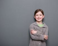 Young girl smiling with arms crossed Stock Photos