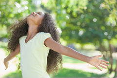 Young girl smiling with arms outstretched Stock Photos