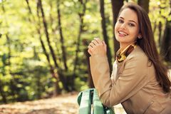 Young  girl smiling in autumn park. Stock Photo