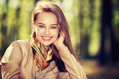 Young  girl smiling in autumn park. Stock Photography