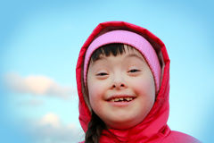 Young girl smiling on background of blue sky Royalty Free Stock Image