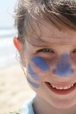 Young girl smiling on the beach. A young girl smiling on the beach with blue zinc Stock Photography