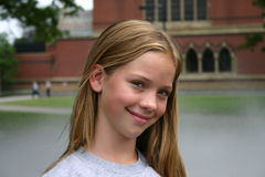 Young girl smiling at Harvard Stock Image