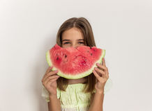 Young girl smiling and eating ripe watermelon. Healthy eating. Stock Image
