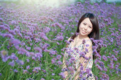 Young girl smiling in the flowers Stock Photo