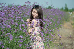 Young girl smiling in the flowers Stock Photography