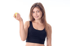 Young girl smiling and holding an apple Royalty Free Stock Photos