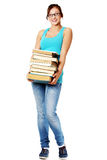 Young girl smiling and holding books. Stock Image