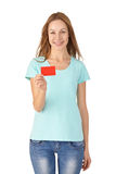 Young girl smiling and holding a card. White background Stock Photos