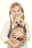 Young girl smiling holding a cute puppy Royalty Free Stock Image