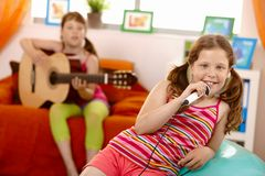 Young girl smiling with microphone in hand Royalty Free Stock Photo