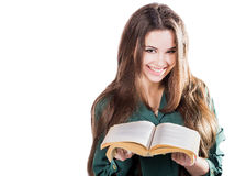Young girl smiling, opened the book to isolate. Is reading. Stock Image