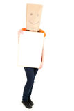 Young girl in smiling paper bag on head with card Stock Photos