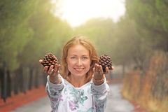 Young Girl Smiling and showing Bumps. The Magic Forest at the Foot of Mount Etna. The island of Sicily, Italy.  royalty free stock photos