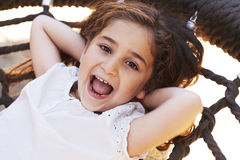 Young girl smiling on swing Stock Photos