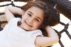 Young girl smiling on swing Stock Photo