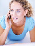 Young girl smiling and talking on mobile phone Royalty Free Stock Image