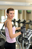 Young girl smiling and about to work out stock image