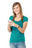 Young girl smiling using mobile phone Stock Photos