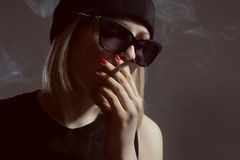 Young girl smoking a cigarette Royalty Free Stock Images