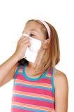Young girl sneezing. Stock Photos