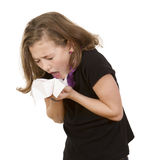 Young girl sneezing stock photo