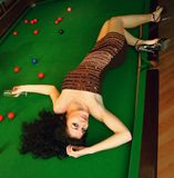 Young girl in snooker bar Royalty Free Stock Photography