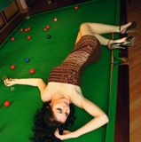Young girl in snooker bar Stock Images