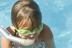 Young Girl Snorkeling at Pool stock images