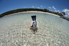 Young girl snorkeling posing like mermaid with wide angle curved horizon royalty free stock images