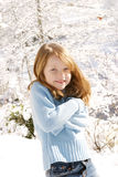 Young girl in snow. Young girl posing in the snow for a portrait Stock Photos
