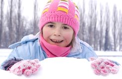 Young girl on the snow Stock Image