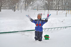 Young girl on snow Stock Images