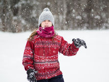 Young girl in the snow royalty free stock images