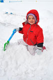 Young girl on snow Stock Image