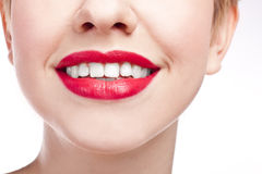 Young girl with snow-white smile. Red lipstick. Close-up happy female smile with healthy white teeth, Cosmetology, dentistry and beauty care. Macro of woman's Stock Image