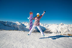Young girl snowboarder jumping in the alpine mountains. stock photography